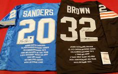 $465.44 GREATEST RUNNING BACKS EVER & GREATEST GIFT EVER!   AUTOGRAPHED BARRY SANDERS & JIM BROWN STAT JERSEYS   The greatest holiday gift for the NFL fan you love! This SUPER FAN lot is perfect for a Man Cave, Sports Bar, or Office. Why buy different pieces when you can buy it all at one time at wholesale prices? Give one gift for Christmas, one gift for a Birthday, one for your Anniversary! It will be the gift he looks forward to getting.