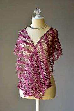 This design is a FREE PATTERN from the Universal Yarn website. This delicate lace scarf is knit on the bias, using Flax and Universe for an interesting texture and a little bit of sparkle! Design by Amy Gunderson.