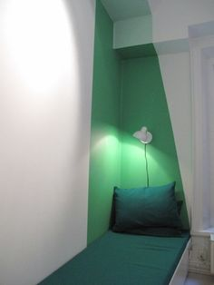 Green painted reading nook with pillow