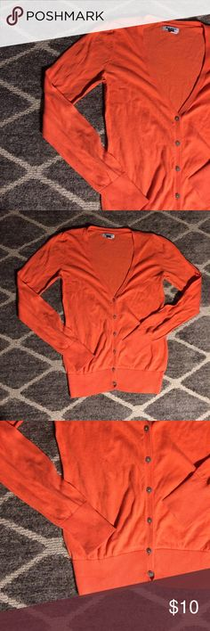 Orange Cardigan Orange button down cardigan. Perfect bright sweater to throw over any outfit to add a nice pop of color! Get this closet essential from me for cheap! :) Old Navy Sweaters Cardigans