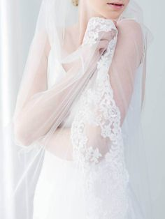 Rosà Wedding Veil A classic tulle bridal veil finished with an elaborate and romantic floral lace trim. These veils are made with soft tulle in white or ivory, and comes in varying length from elbow and fingertip to chapel and cathedral. Reminiscent of antiquated times, Rosà's detailed floral trim is perfect for both the traditional bride and the boho bride wanting a little extra detail to her wedding day look. If you would prefer a drop veil: https://www.etsy.com/listing/...
