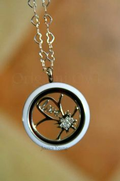 "Creative Origami Owl. White face Twist Locket with Flower Insert and ""love"" charm. Simply Beautiful."