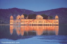 """Jal Mahal (meaning """"Water Palace"""") is a palace located in the middle of the Man Sagar Lake in Jaipur city,India.Traditional boat-makers from Vrindavan have crafted the Rajput style wooden boats. A gentle splashing of oars  takes you to Jal Mahal. You move past decorated hallways and chambers on the first floor to climb all the way up to the fragrant Chameli Bagh. Across the lake, you can view the Aravalli hills, dotted with temples and ancient forts, and on the other side, bustling Jaipur."""