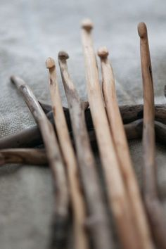 Wooden sticks made into crochet hooks ~ Wabi Sabi. I have a few of these that were carved for a grateful wife.