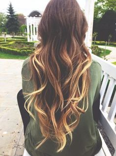Effortless and chic, we love these cascading ombre curls.