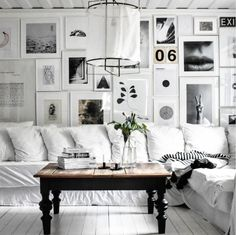 my scandinavian home: white linen sofa and gallery wall in the beautiful country home of Therese Johansen.