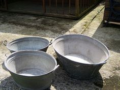 £26 for all 3..... Ice buckets? Keep the bottle in etc?.... Can be used afterwards for storage like in that picture..