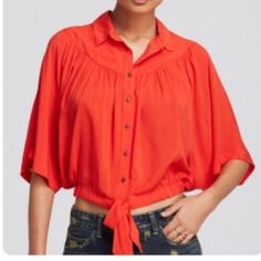 """Free people Coral """"Sheila's elbow"""" top slouchy, elbow-sleeve top cut from ethereal fabric is elasticized at the cropped hemline and secured with a front tie closure for a midriff-flashing finish. Brand: Free People. Style Name: Free People 'Sheila's' Drape & Tie Top. Style Number: 1027189. Free People Tops"""