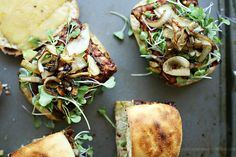 Vegetarian BBQ tempeh burgers with cheddar, avocado, caramelized onions, and microgreens #YummyMummyKitchen