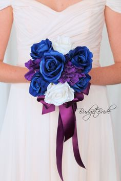 This stunning brides bouquet is round bouquet with royal blue and white roses accented with purple hydrangea. This bouquet is approx 10 inches wide Orchid Bridal Bouquets, Bride Bouquets, Boho Wedding, Dream Wedding, Wedding Day, Blue And White Roses, Wedding Planning Boards, Davids Bridal Gowns, Budget Bride