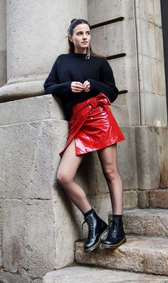 black sweater red skirt black boots tights