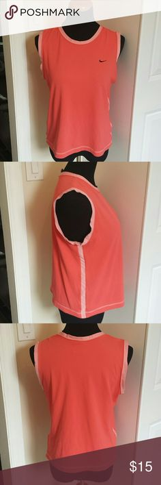 Nike dryfit coral runners workout top Fun colored top for running and working out. Wiks away moisture to keep you dry while you sweat it out on the track or at the gym. Feel free to make an offer! Nike Tops Muscle Tees