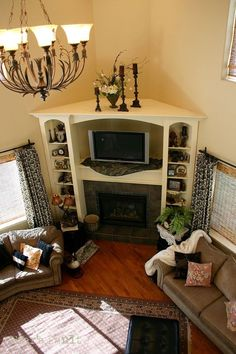 solution for corner fireplace? built in bookcase and entertainment center.:
