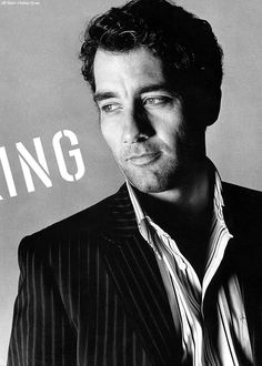 "Clive Owen- I wonder what the word is beside him that ends in ""ing""."