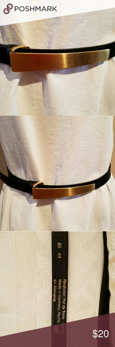Vintage Mondi Gold & Black Leather Belt This attractive belt is in excellent used condition.  Buckle is perfect. You have too look hard to find small scratches. It's very high quality made in Germany. The back says European 44 and 89, possible made in 1989. The belt measures 42 inches, but has a bunch of holes, so it can be made smaller. So likely fits 10-12. It's very pretty and would cost a small fortune today if you could even find it. Mondi Accessories Belts
