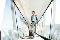 Buy Mature businessman with suitcase travelling. by halfpoint on PhotoDune. Mature businessman walking in the corridor with suitcase, travelling.