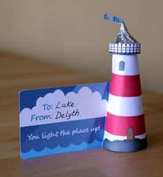 I've designed you a printable to make these sweet little lighthouse valentine favors. You sit a Hershey's Kiss in the top of it as the light...