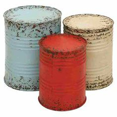 """3 distressed metal end tables with grooved drum-inspired designs.     Product: Small, medium and large end tableConstruction Material: MetalColor: Red, blue and whiteDimensions: Small: 16"""" H Medium: 18"""" HLarge: 20"""" H"""