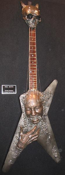 Dimebag's collectors electric art piece-teeth pulling string