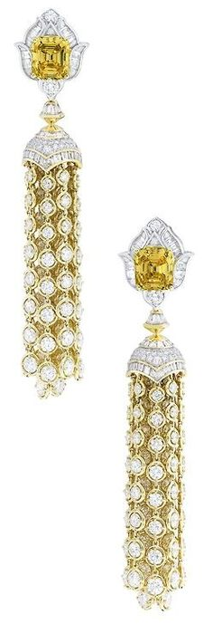 Van Cleef & Arpels Precious Light earrings with baguette cut diamonds, emerald cut fancy vivid orange yellow diamonds, set in white gold and yellow gold. Via the Jewellery Editor. Yellow Jewelry, I Love Jewelry, High Jewelry, Luxury Jewelry, Jewelry Design, Statement Jewelry, Diamond Trade, Diamond Cuts, Van Cleef And Arpels Jewelry