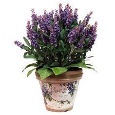Faux lavender arrangement in a French-labeled planter.  Product: Faux floral arrangementConstruction Material: Silk, c...