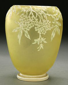 A WEBB CAMEO GLASS VASE circa 1900 in citrine glass overlaid with opal and carved with fruit blossoms