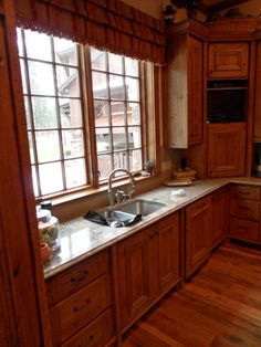 Timberline Framers Inc, Pagosa Springs, Colorado. Large window overlooking Colorado mountains in kitchen. Big beautiful sink and custom made cabinets.