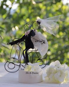 One of a kind wedding cake topper