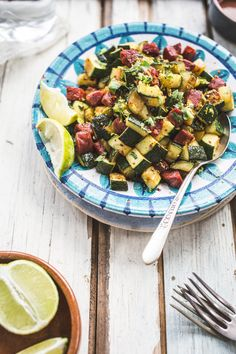 Once the summer glut of zucchini arrives, it's easy to get tired of eating them. The good thing is that they have a mild, sweet flavor that works well with a lot of other ingredients and cuisines. Here I've given a basic dish of sautéed zucchini a bit of a twist with the addition of smoky chorizo and hits of fresh lime and cilantro.