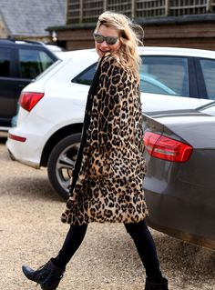 Kate Moss made an animalistic statement flaunting a leopard print, furry jacket, topped off with blue cat-eye sunnies!