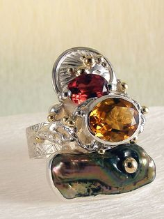 http://www.designerartjewellery.com Copy the link and paste to the address bar of your browser and hit return and visit our website which shows only one of a kind originals by jewellery artist Gregory Pyra Piro. Visit the site and support independent made art jewellery.