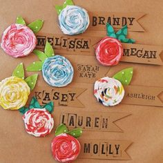 These would be great with layered fabric stars and a button in place of the flower. Marissa has stamps from our journal craft last year.