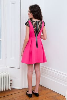 New season party wear has officially arrived with this pretty fuchsia and lace neoprene prom dress. A popular choice for young ladies who adore setting their own fashion trends, your girl will fall in love with what this unique wardrobe staple offer. Featuring a bold fuchsia pink colour way with contrasting black lace inserts at the cap sleeves and at the back of the dress, this piece is all about sophistication. Whether your young style icon is looking for that special prom dress or she…