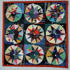 """Recycled Ballroom 'Suitcase' quilt by bearpawandbearpaw. She says: """"I made this for a Quilter's Guild 'Suitcase' exhibition in the 90's. The quilts have to be small enough to travel in a suitcase. It went all around Europe for 2 years. It is also a 'Green Quilt'. Drunkards Path again, machine pieced and quilted with buttons in the centre of each block. All silk remnants from local dress maker."""""""