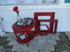 Vintage oval two tier end table in red. Modern Vintage