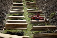 A worker prepares graves ahead of a ceremony at a memorial center for the victims of the Srebrenica massacre in Potocari, Bosnia and Herzegovina July 7, 2014. Family members, foreign dignitaries and guests are expected to attend a ceremony in Srebrenica on July 11 marking the 19th anniversary of the massacre in which Bosnian Serb forces commanded by Ratko Mladic killed up to 8,000 Muslim men and boys. The remains of 175 identified victims will be buried at a memorial cemete. REUTERS/Dado…