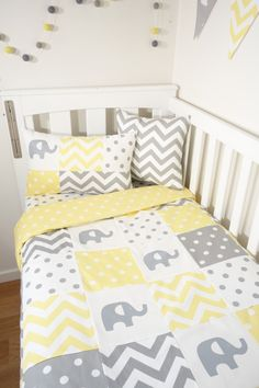 A gorgeous and classic grey and yellow patchwork elephant cot quilt, transitions seamlessly into a modern nursery. Coordinating with the plush, yellow with white spot backing fabric, it is a perfect gender neutral nursery set. - Patchwork cot quilt (100cm x 130cm): Grey and yellow fabric patches with 4 screenprinted grey elephants AND yellow spot backing fabric ** With a 200gsm quilt wadding sewn into this easy care, generous sized quilt, it is warm and soft for your little one.