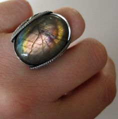 http://www.etsy.com/listing/83457161/labradorite-ring-rainbow-pink-stone