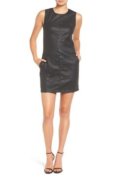 A slim-fitting sleeveless shift dress is rendered in lustrous coated denim for an edgy, leather-like look. Pieced seam details and convenient front pockets complete the sleek, cool-girl style.