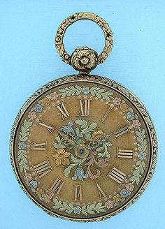 Fine and beautiful English 18K gold lever and fusee by Tobias circa 1819. Matte gold dial with applied numerals and lavish applied multicolor gold floral decorations. Fancy gold hands. Substantial engine turned case (the back with a crease) with cast and chased bezels, pendant and bow. Full plate movement with diamond cap jewel.
