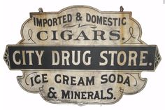 "American Garage Gallery- Late 19th century wood double sided shaped City Drug Store sign, constructed from a single wide board 55"" wide x 35"" high x 1"" deep"