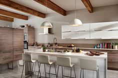 Light Walnut lower Cabinets. White uppers with horizontal open. Island chairs with backs. Beams. Waterfall island counter