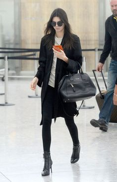 Kendall Jenner at London's Heathrow airport. See all of the star's best looks.