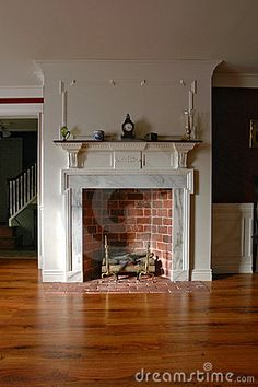 Fireplace in Antique Colonial Style Home Interior by Olivier Le Queinec, via Dreamstime