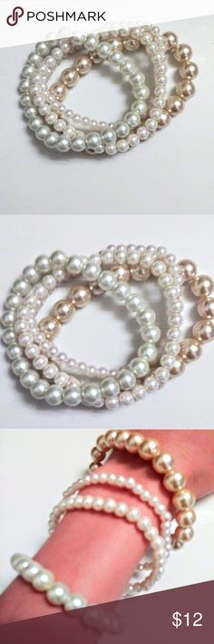 Set of 4 Faux Pearl Bracelets NWOT Set of 4 faux pearl bracelets. Each bracelet has unique pearl size, creates a beautiful eclectic look when worn together as shown in picture. Stretchy bands. NWOT. Jewelry Bracelets