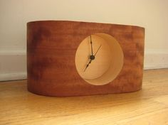 How to build a curved wooden clock from wood veneer and laser cut parts.