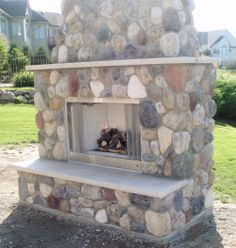 Free-standing outdoor fireplace with beautiful stone-work