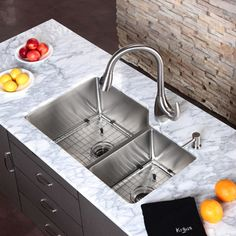 Double Sink With Draining Board So That You Can Wash, Then Rinse, Then Dry  And Let All Of The Water Run Down The Drain Instead Of On The Counter.