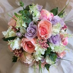 A wedding bouquet of lilac & pink artificial silk flowers
