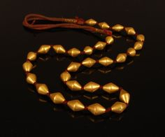 Gold Dowry Beads with wax core. India, Mid-20th century